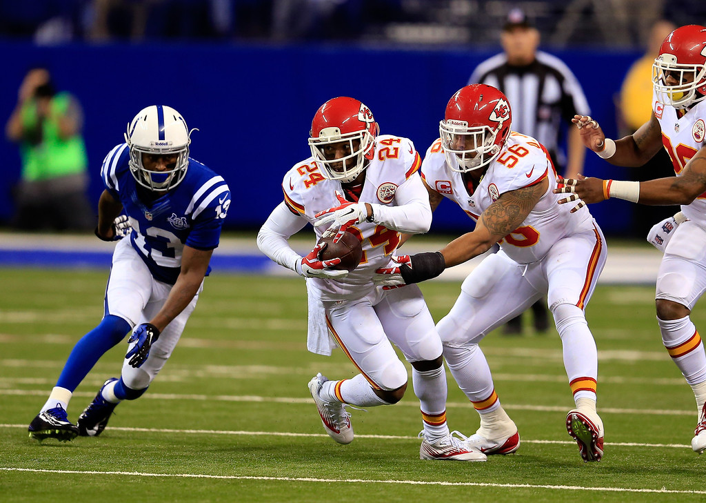 . INDIANAPOLIS, IN - JANUARY 04: Cornerback Brandon Flowers #24 of the Kansas City Chiefs runs after an interception against the Indianapolis Colts during a Wild Card Playoff game at Lucas Oil Stadium on January 4, 2014 in Indianapolis, Indiana.  (Photo by Rob Carr/Getty Images)