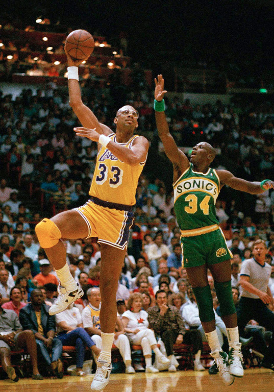 . FILE - In this April 24, 1989, file photo, Los Angeles Lakers\' Kareem Abdul-Jabbar goes up on a sky hook against Seattle Sonics\' Xavier McDaniel during an NBA game in Inglewood, Calif. Abdul-Jabbar is being treated for a rare form of leukemia, and the basketball great said that his prognosis is encouraging. (AP Photo/Reed Saxon, File)