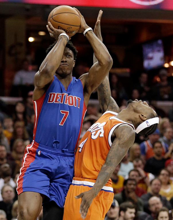 . Detroit Pistons\' Stanley Johnson (7) shoots over Cleveland Cavaliers\' Iman Shumpert (4) in the second half of an NBA basketball game, Tuesday, March 14, 2017, in Cleveland. (AP Photo/Tony Dejak)