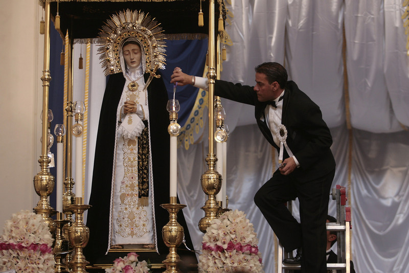 . A man lights candles next to the statue of the Virgin Mary during a procession in the center of Palermo as part of the Good Friday celebrations on April 18, 2014. (MARCELLO PATERNOSTRO/AFP/Getty Images)