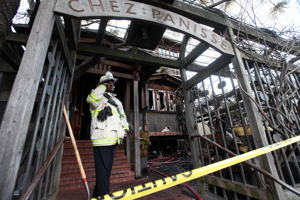 . Acting Deputy Fire Chief Avery Webb in the entrance to Chez Panisse where an early morning fire broke out damaging the front area of the restaurant in Berkeley, Calif. on Friday , March 8, 2013. Officials are calling the fire, which started under the front porch, suspicious.(Laura A. Oda/Staff)