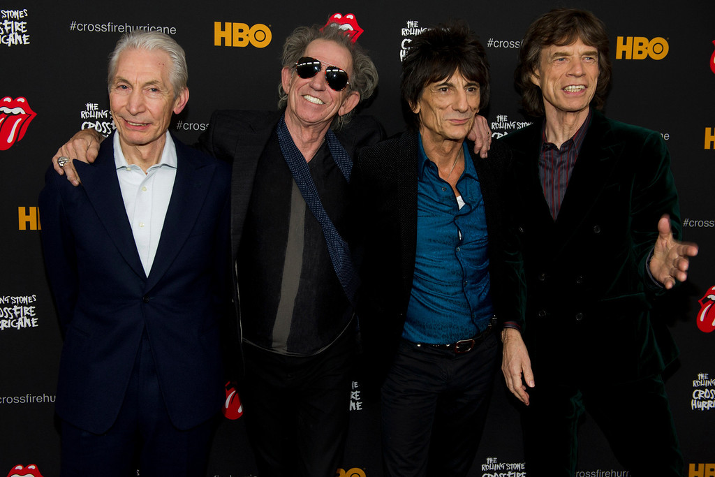 ". Rolling Stones band members, from right, Mick Jagger, Ronnie Wood, Keith Richards and Charlie Watts attend ""The Rolling Stones Crossfire Hurricane\"" premiere on Tuesday, Nov. 13, 2012 in New York. (Photo by Charles Sykes/Invision/AP)"
