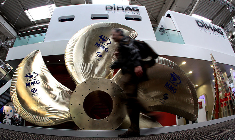 . A visitor walks past at a screw propeller at DIHAG Holding\'s booth at the industrial trade fair in Hanover, central Germany on April 8, 2013. The fair running from April 8 to 12, 2013 will present a cross section of key industrial technologies.    RONNY HARTMANN/AFP/Getty Images