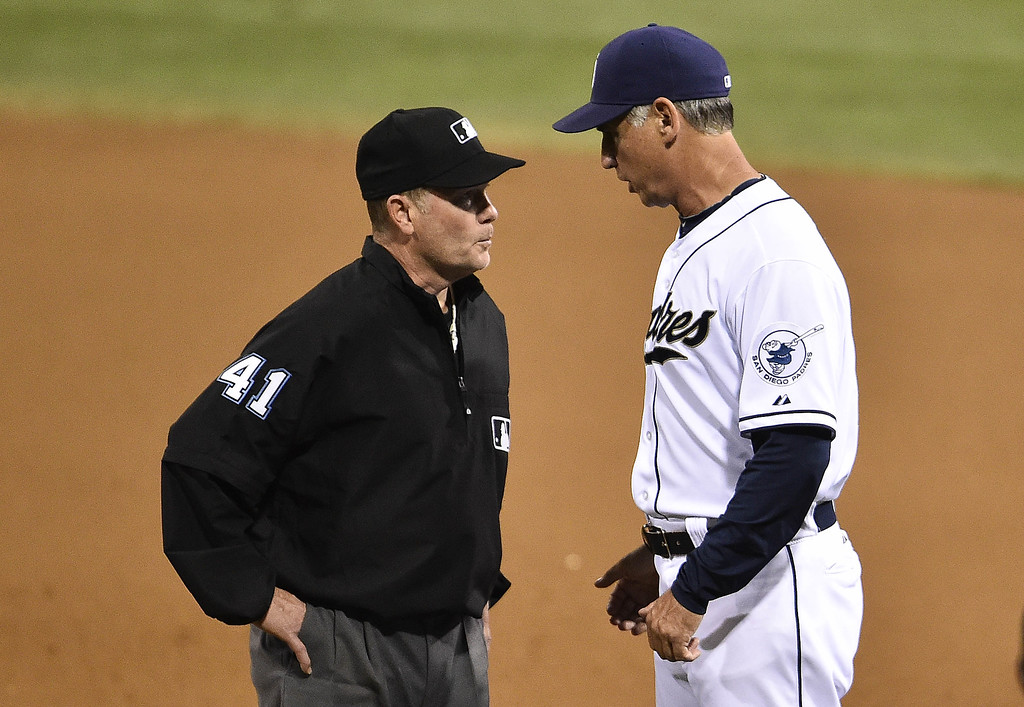 . SAN DIEGO, CA - SEPTEMBER 24:  Bud Black #20 manager of the San Diego Padres argues a call with umpire Jerry Meals during the fourth inning of a baseball game against the Colorado Rockies at Petco Park September, 24, 2014 in San Diego, California.  (Photo by Denis Poroy/Getty Images)