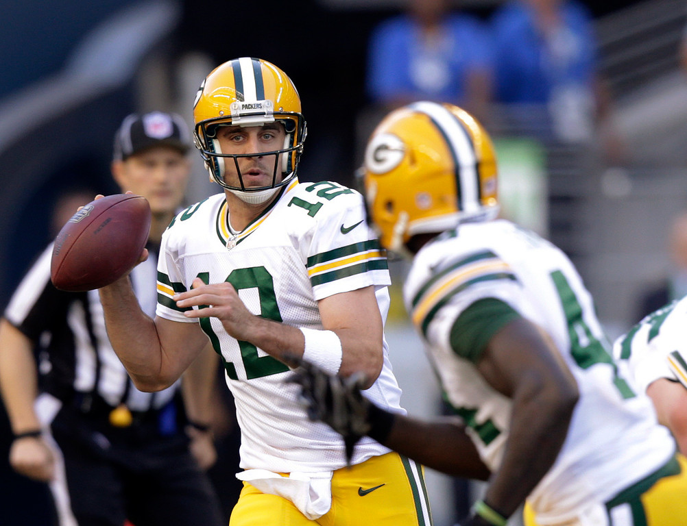 . Green Bay Packers quarterback Aaron Rodgers looks to pass against the Seattle Seahawks in the first half of an NFL football game, Thursday, Sept. 4, 2014, in Seattle. (AP Photo/Stephen Brashear)