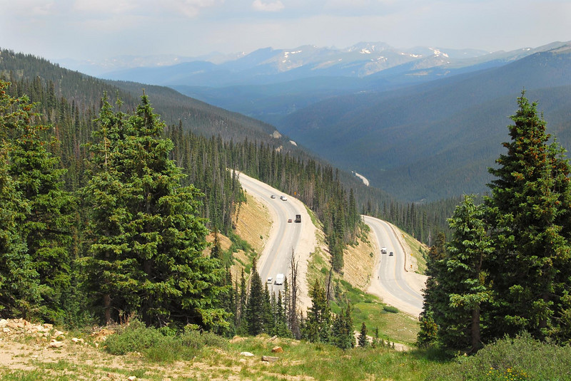 7/16/07 – Our trip to Denver was too short. We decided to take the scenic route home rather than the freeway. This is Highway 40 climbing over the Continental Divide in Colorado. We are at an elevation of 11,300 feet looking west towards Utah and home.