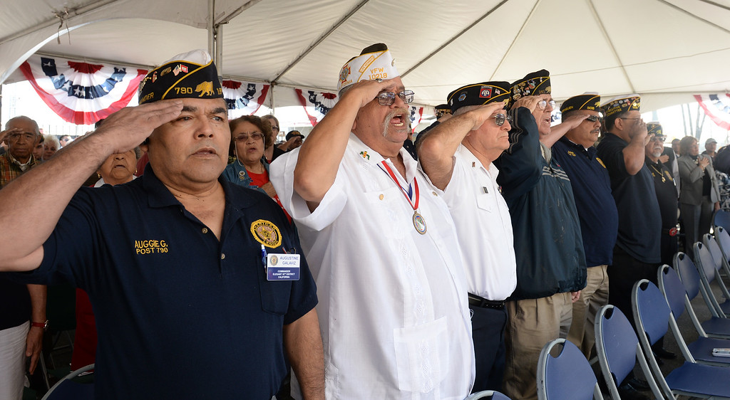 . Veterans sing the National Anthem during the Grand Opening of the El Monte Veterans Village on Ramona Blvd. in El Monte on Wednesday March 12, 2014. The Veterans Village is a state-of-the-art veterans housing community includes 40 studio apartments. (Staff Photo by Keith Durflinger/San Gabriel Valley Tribune)