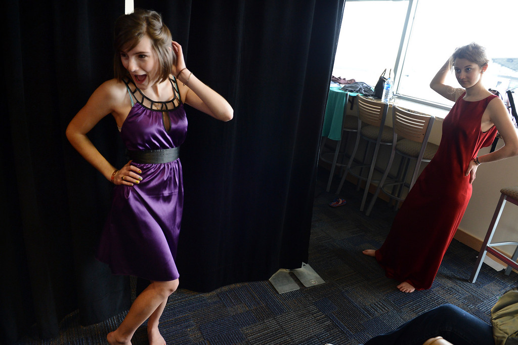 """. COMMERCE CITY, CO. - MARCH 16: Silka Cole, left, and Alexandra Contra, both seniors at Evergreen High School, share a laugh while trying on dresses at the Prom Dress Exchange Corp. event in Commerce City, CO March 16, 2013. With a valid student ID and a suggested $10 donation, teenage girls could chose from 1,356 donated dresses that lined a long hallway at Dick�s Sporting Goods Park. Contra, an exchange student from Germany, said she appreciates the price, \""""if I buy a dress I will never wear it again.\"""" (Photo By Craig F. Walker/The Denver Post)"""