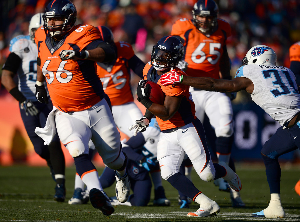 . Denver Broncos running back Knowshon Moreno (27) makes a first down run in the first quarter. The Denver Broncos take on the Tennessee  (Photo by AAron Ontiveroz/The Denver Post)