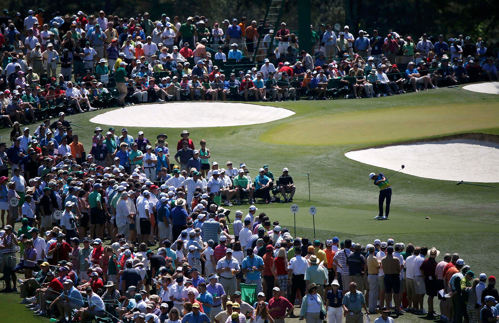 . Rickie Fowler of the U.S. hits his tee shot on the third hole during third round play in the 2013 Masters golf tournament at the Augusta National Golf Club in Augusta, Georgia, April 13, 2013.  REUTERS/Mike Segar