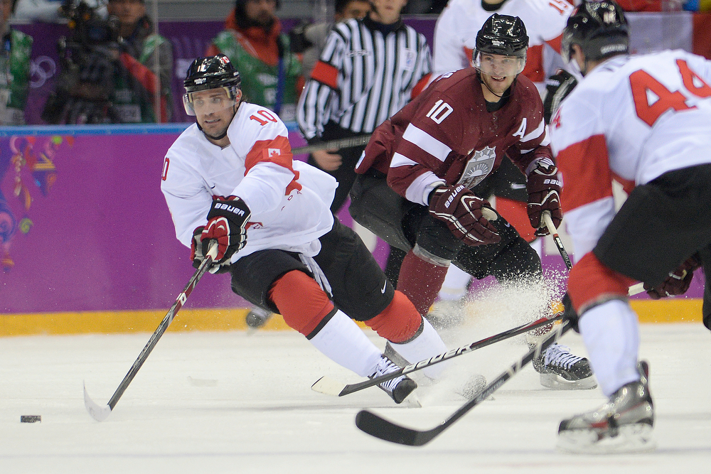 . Patrick Sharp (10) of the Canada controls the puck against Latvia during the second period of men\'s hockey action. Sochi 2014 Winter Olympics on Wednesday, February 19, 2014 at Bolshoy Ice Arena. (Photo by AAron Ontiveroz/ The Denver Post)