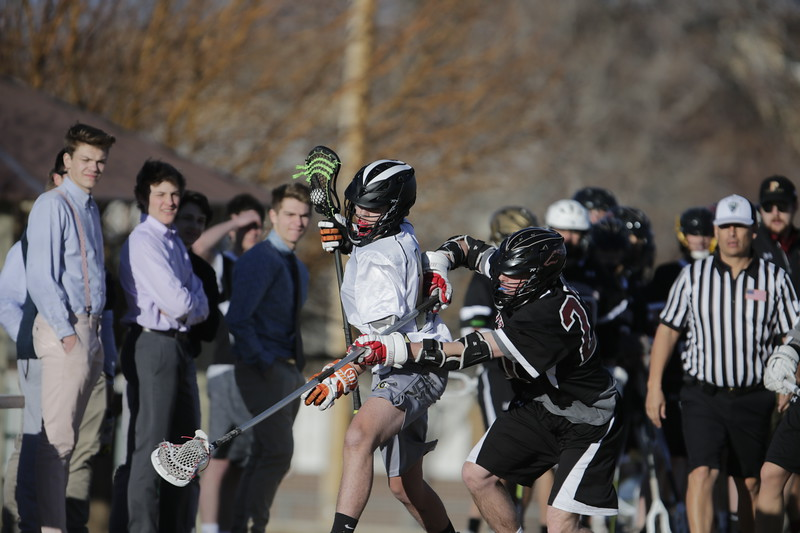 JPM0055-JPM0055-Jonathan first HS lacrosse game March 9th.jpg