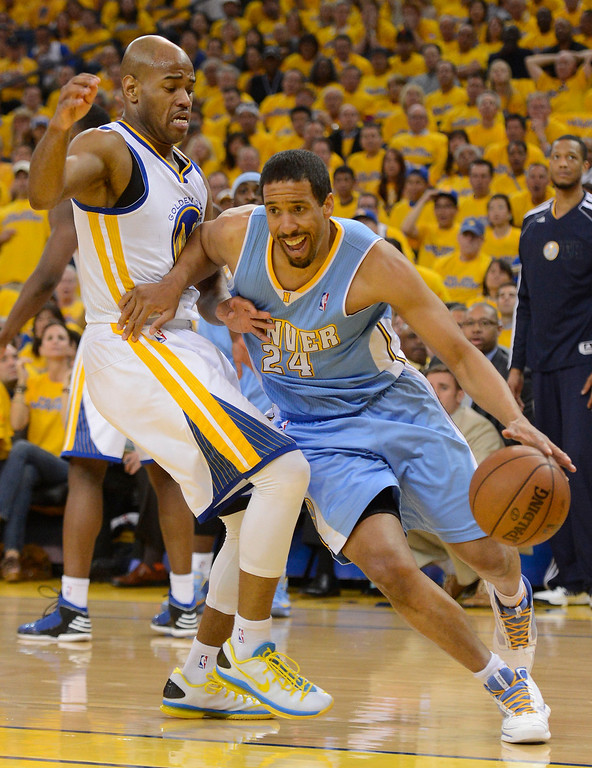. Andre Miller (24) of the Denver Nuggets drives on Jarrett Jack (2) of the Golden State Warriors during the second quarter in Game 6 of the first round NBA Playoffs May 2, 2013 at Oracle Arena. (Photo By John Leyba/The Denver Post)