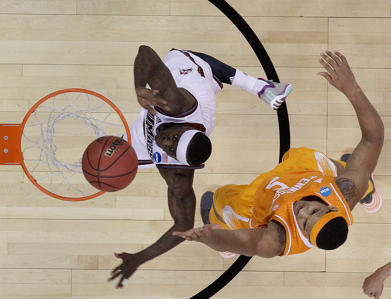 . Massachusetts guard Chaz Williams (3) shoots against Tennessee forward Jarnell Stokes (5) during the first half of an NCAA college basketball second-round tournament game, Friday, March 21, 2014, in Raleigh. (AP Photo/Chuck Burton)