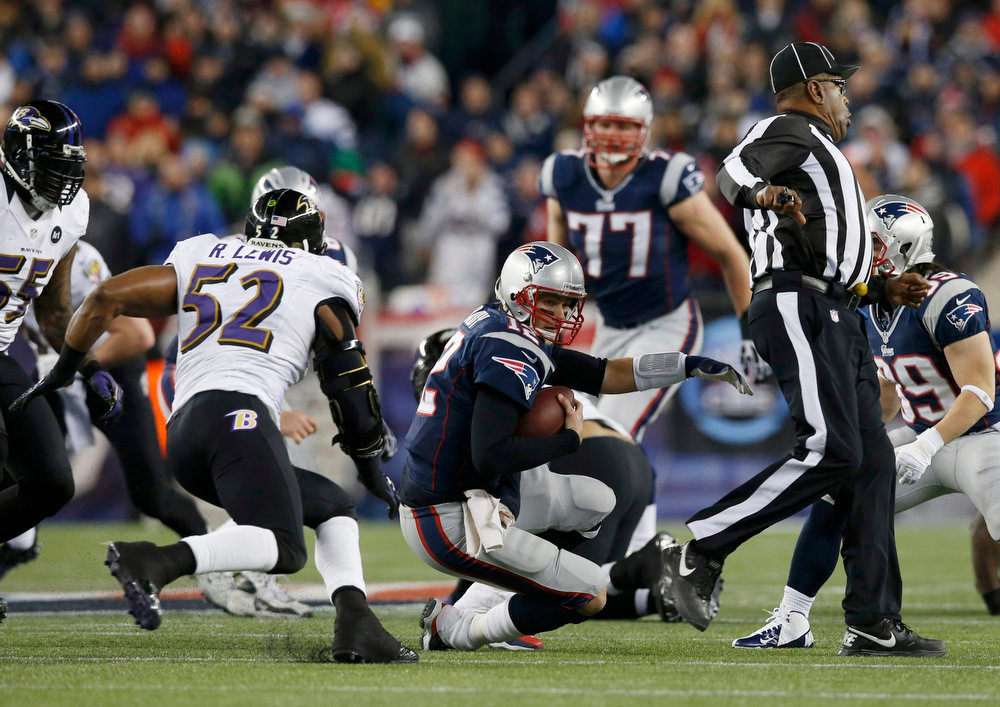 . The referee gets in the way of New England Patriots quarterback Tom Brady (12) as he tries to run for a first down while being chased by Baltimore Ravens inside linebacker Ray Lewis (52) in the first half of the NFL AFC Championship football game in Foxborough, Massachusetts, January 20, 2013. REUTERS/Mike Segar