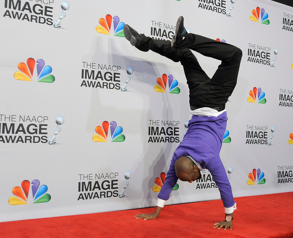 . Wyclef Jean does a handstand backstage at the 44th Annual NAACP Image Awards at the Shrine Auditorium in Los Angeles on Friday, Feb. 1, 2013. (Photo by Chris Pizzello/Invision/AP)