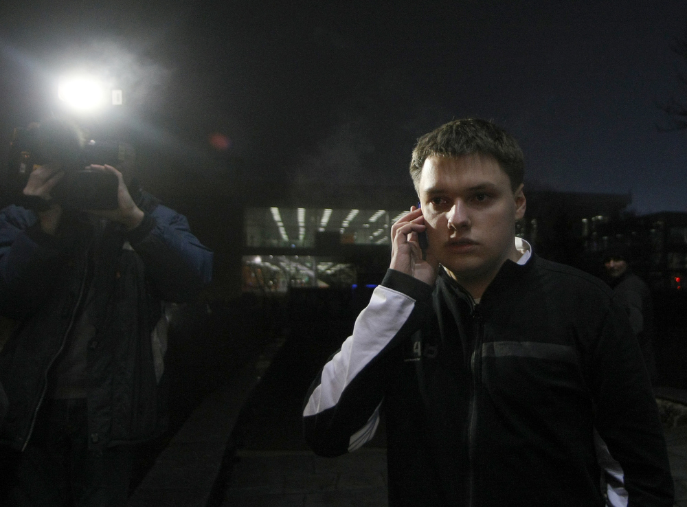 ". Oleh Osheka, one of the passenger of Antonov AN-24 plane which made an emergency landing in the eastern Ukraine city of Donetsk, on February 13, 2013 . ""Most passengers have been rescued. Right now, we have four dead,\"" local governor Andrey Shyshatsky told reporters at the airport. The plane was flying from the resort city of Odessa in the south when it overturned and began breaking up upon landing at Donetsk airport.  Alexander KHUDOTEPLY/AFP/Getty Images"