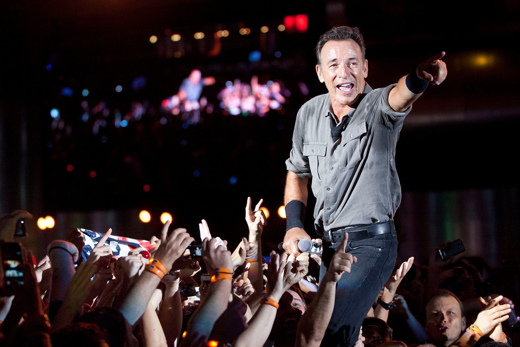 . In this Sunday, Sept. 22, 2013 photo, Bruce Springsteen performs on the last night of the Rock in Rio music festival in Rio de Janeiro, Brazil. More than an estimated 80 thousand people a day attended the week-long festival, that featured over 120 bands and artists. Conceived by the entrepreneur Roberto Medina, the first Rock in Rio took place in the Rio de Janeiro in 1985. (AP Photo/Felipe Dana)