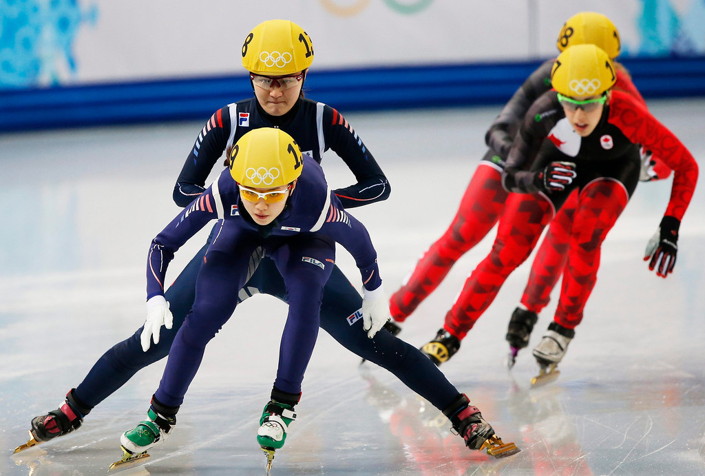 . Korea\'s Park Seung-Hi passes on to Shim Suk Hee (foreground) in the semi final 1 in the women\'s 3000m relay of the Short Track competitions in the Iceberg Skating Palace at the Sochi 2014 Olympic Games.  EPA/BARBARA WALTON