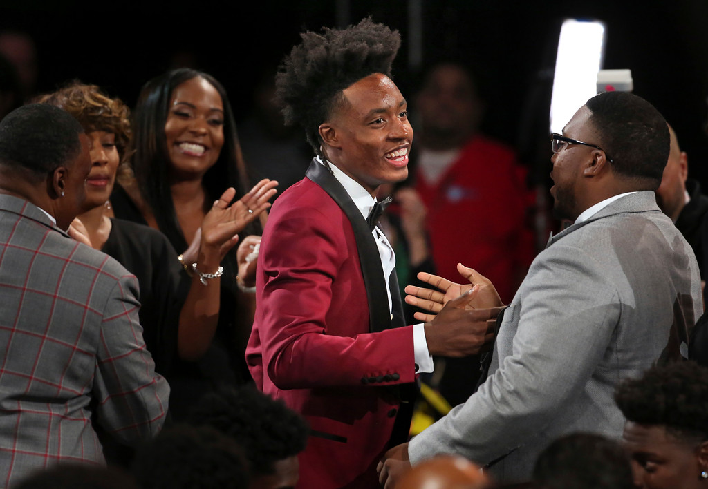 . Alabama\'s Collin Sexton is congratulated by friends and family after he was picked eighth overall by the Cleveland Cavaliers during the NBA basketball draft in New York, Thursday, June 21, 2018. (AP Photo/Kevin Hagen)