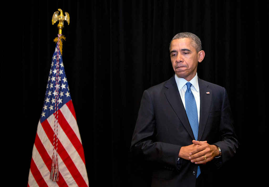 . President Barack Obama pauses as he speaks about the shooting at Fort Hood, Wednesday, April 2, 2014, in Chicago. (AP Photo/Carolyn Kaster)