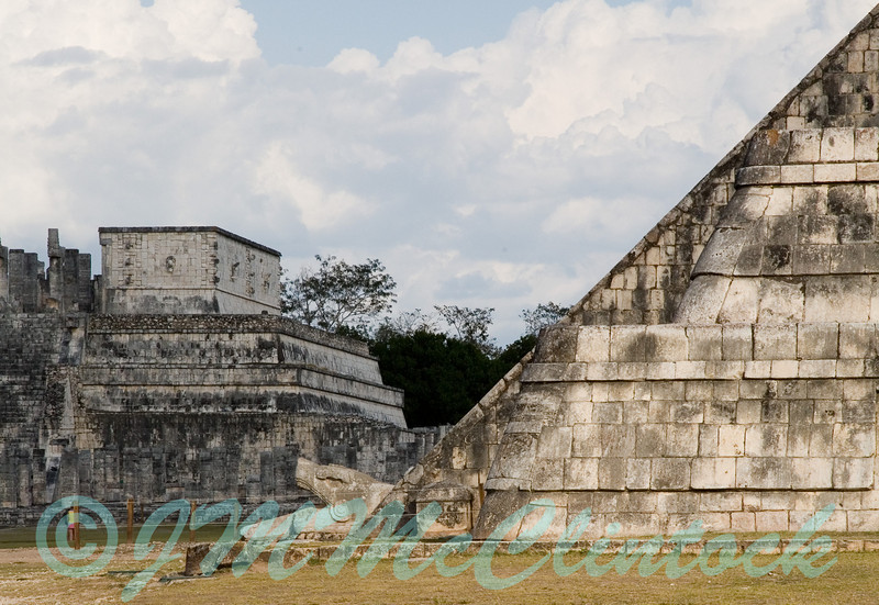 The head of the snake at the base of the Mayan pyramid.