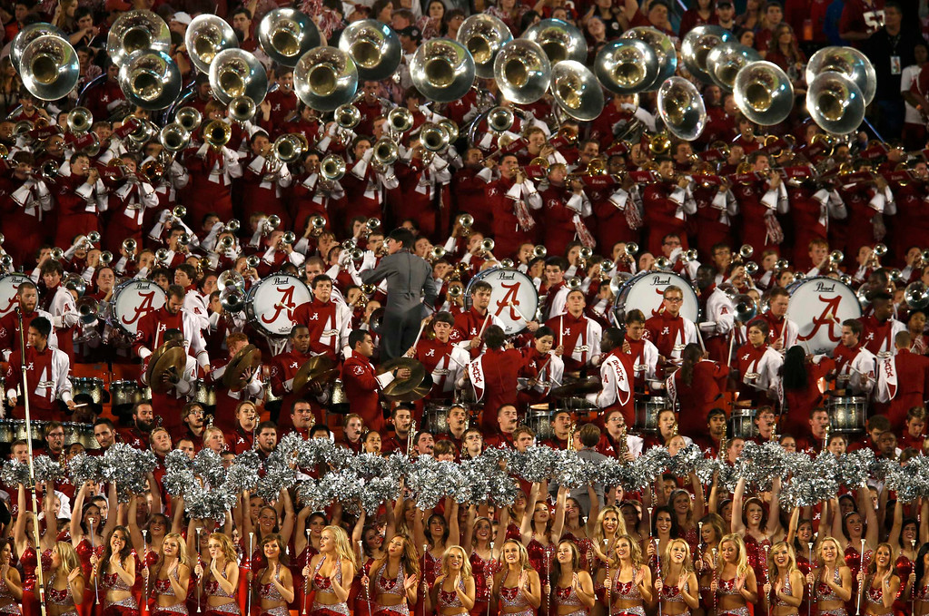 . The Alabama Crimson Tide band and cheerleaders perform during the first quarter of the NCAA National Championship college football game against the Notre Dame Fighting Irish in Miami, Florida, January 7, 2013.  REUTERS/Mike Segar
