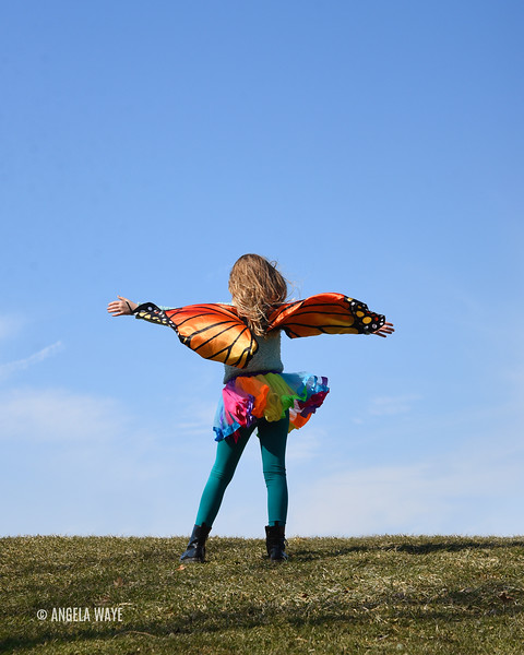 Creative Butterfly Girl Standing Outside