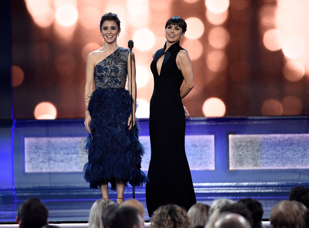 . Shiri Appleby, left, and Constance Zimmer present the award for best movie made for television or limited series at the 22nd annual Critics\' Choice Awards at the Barker Hangar on Sunday, Dec. 11, 2016, in Santa Monica, Calif. (Photo by Chris Pizzello/Invision/AP)