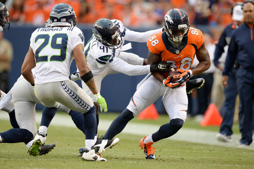 . Wide receiver Demaryius Thomas (88) of the Denver Broncos picks up a first down as cornerback Byron Maxwell (41) of the Seattle Seahawks brings him down during the first quarter August 7, 2014 at Sports Authority Field at Mile High Stadium.  (Photo by John Leyba/The Denver Post)