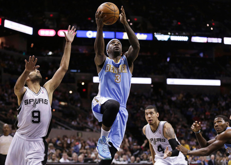 . Denver Nuggets\' Ty Lawson (3) drives past San Antonio Spurs\' Tony Parker (9), of France, and Danny Green (4) to score during the second half of an NBA basketball game, Wednesday, March 27, 2013, in San Antonio. San Antonio won 100-99. (AP Photo/Eric Gay)