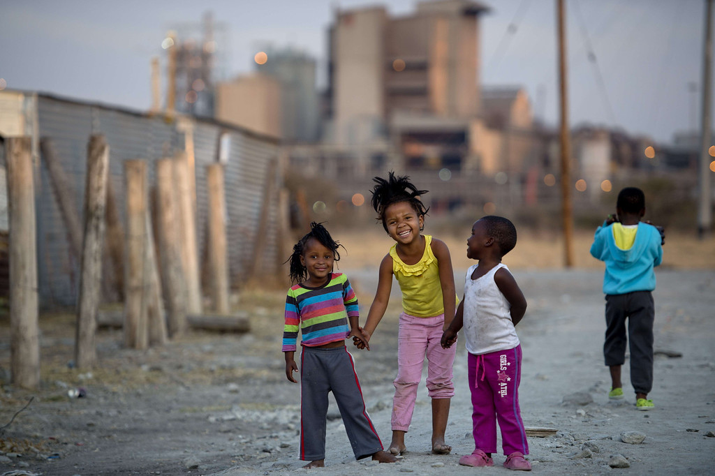 . Children play on July 9, 2013 in the Nkaneng shantytown next to the platinum mine, run by British company Lonmin, in Marikana. On August 16, 2012, police at the Marikana mine open fire on striking workers, killing 34 and injuring 78, during a strike was for better wages and living conditions. Miners still live in dire conditions despite a small wage increase.  ODD ANDERSEN/AFP/Getty Images