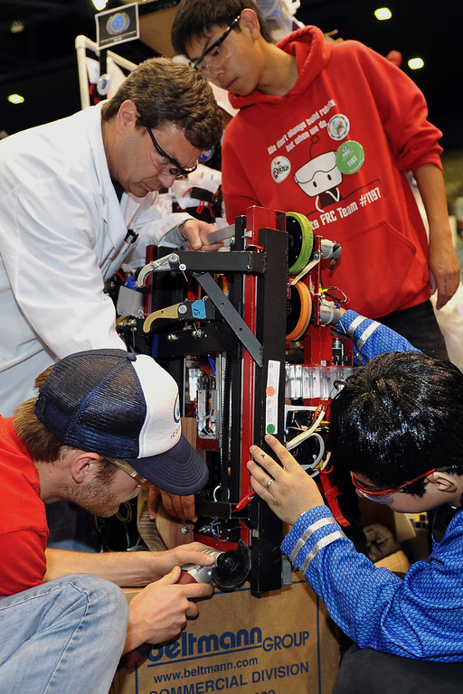 . 3/22/13 - Members of the Torrance High School team, which includes all four area high schools prepare their robot for the next match at the robotic competition on Friday morning. More than 1,500 high school students from California, Hawaii and Chile are competing in the 22nd FIRST Robotics Los Angeles Regional Competition at the Long Beach Arena.This years robotic task is throwing discs for points. Photo by Brittany Murray / Staff Photographer