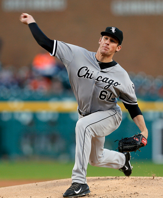 . Chicago White Sox pitcher Chris Bassitt throws against the Detroit Tigers in the first inning of a baseball game in Detroit Monday, Sept. 22, 2014. (AP Photo/Paul Sancya)