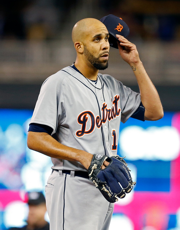 . Detroit Tigers pitcher David Price waits for a visit by the pitching coach in the fourth inning of a baseball game against the Minnesota Twins, Monday, April 27, 2015, in Minneapolis. (AP Photo/Jim Mone)