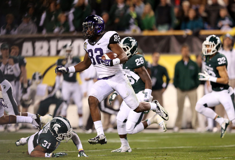 Description of . Wide receiver Josh Boyce #82 of the TCU Horned Frogs runs with the football on a 61 yard reception during the Buffalo Wild Wings Bowl against the Michigan State Spartans at Sun Devil Stadium on December 29, 2012 in Tempe, Arizona.  (Photo by Christian Petersen/Getty Images)