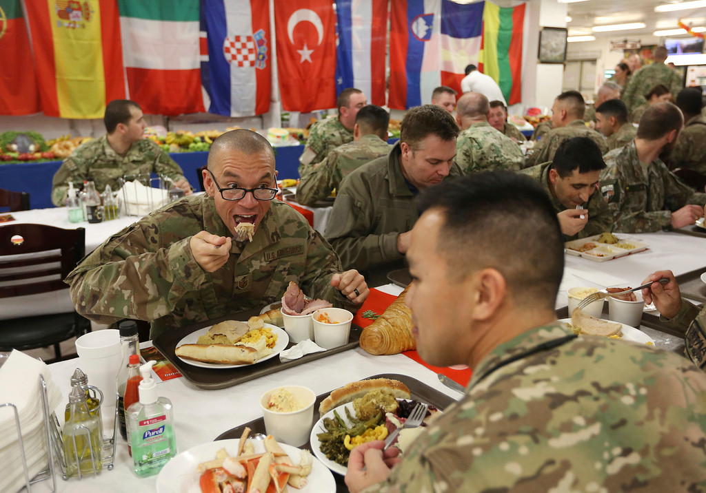 . NATO soldiers have their Thanksgiving day meal at Resolute Support headquarters, in Kabul, Afghanistan, Thursday, Nov. 24, 2016. (AP Photo/Rahmat Gul)