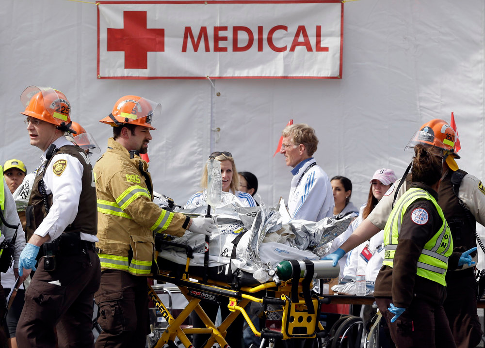 . Medical personnel work outside the medical tent in the aftermath of two blasts which exploded near the finish line of the Boston Marathon in Boston, Monday, April 15, 2013. (AP Photo/Elise Amendola)