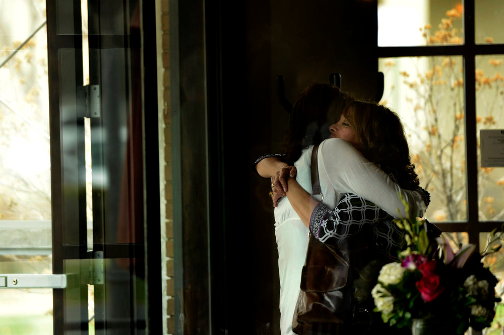 . Tammy Cunningham, owner of Strings Restaurant has a long hug at the doorway for her dear friend Kathe Peachey when she comes for the last day of service as the Denver favorite closes after nearly 30 years April 30, 2013 Denver, Colorado. (Photo By Joe Amon/The Denver Post)