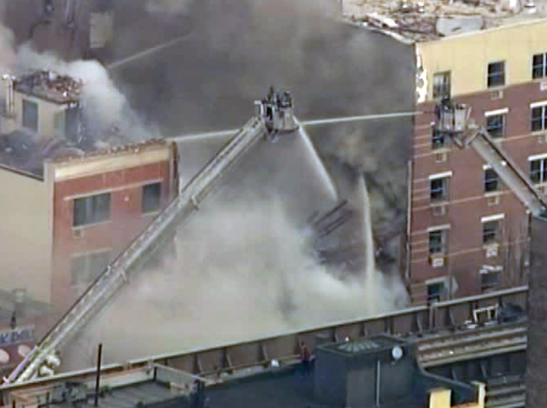. In this image taken from video from WABC, firefighters battle a blaze at the site of a possible explosion and building collapse in the East Harlem neighborhood of New York, Wednesday, March 12, 2014. (AP Photo/WABC-TV)