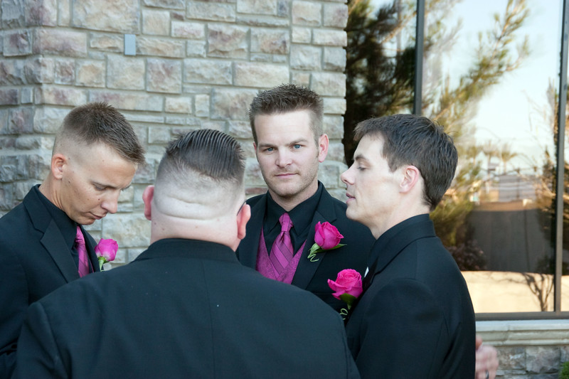 Groom and ushers in their little cabal.