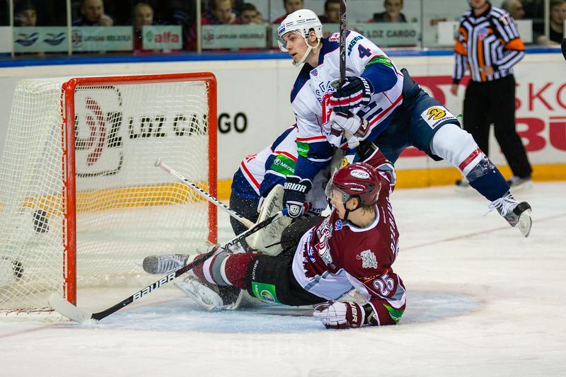 Andris Dzerins (25) and Davydov Ilya (4) fall into the goal of Torpedo Nizhny Novgorod
