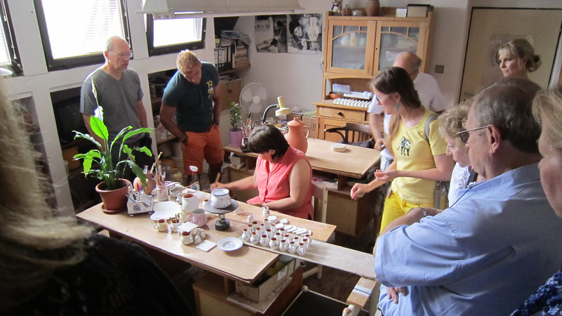 """Our hosts for a """"home visit"""" in Bratislava Region, Slovakia. Showing pottery painting."""