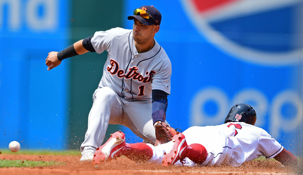 . Detroit Tigers\' Jose Iglesias, left, waits for the ball as Cleveland Indians\' Rajai Davis steals second base in the second inning of a baseball game, Sunday, June 24, 2018, in Cleveland. (AP Photo/David Dermer)