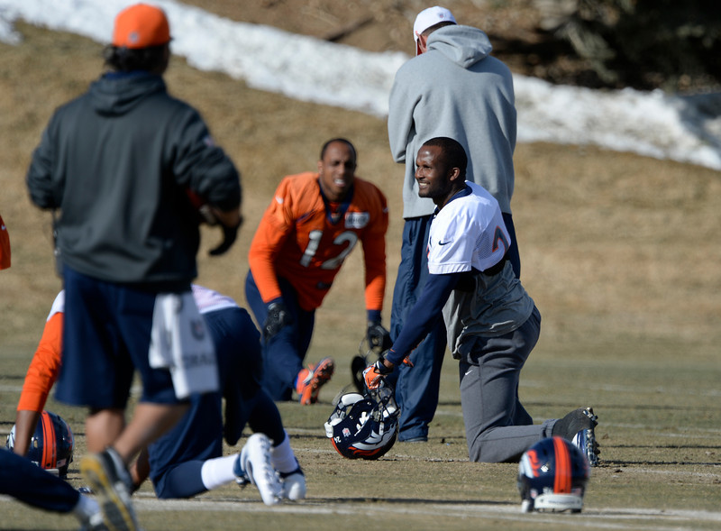 . Denver Broncos cornerback Champ Bailey (24) stretches before practice January 9, 2014 at Dove Valley (Photo by John Leyba/The Denver Post)