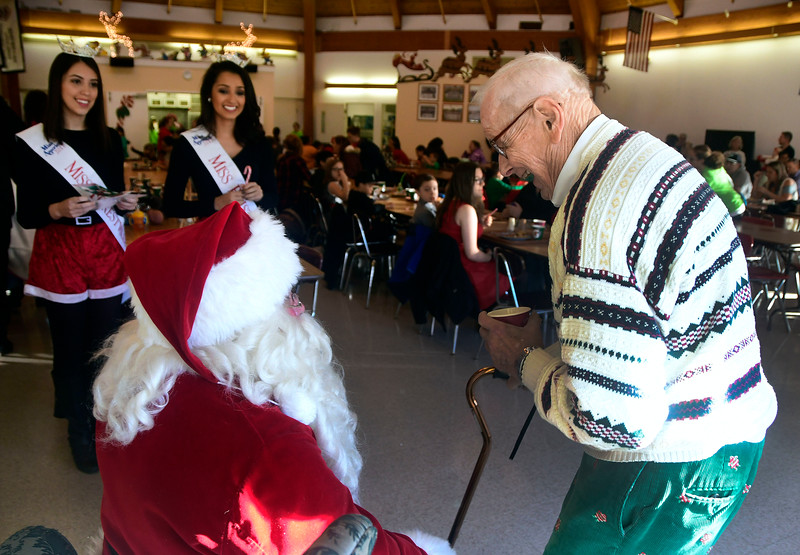 "12/3/2016 Mike Orazzi | Staff Bill Stortz talks with Santa, Bob Boudreau, during the Giamatti Little League Center's ""23rd Annual Breakfast with Santa Saturday morning."