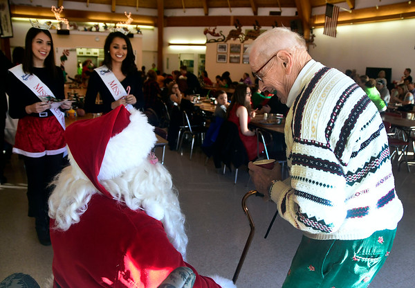 "12/3/2016 Mike Orazzi | Staff Bill Stortz talks with Santa, Bob Boudreau, during the Giamatti Little League Center's ""23rd Annual Breakfast with Santa Saturday morning."