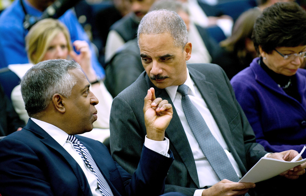 . Acting Director of the US Bureau of Alcohol, Tobacco, Firearms and Explosives Todd Jones (L) speaks with US Attorney General Eric Holder (C) during an event unveiling a package of proposals to reduce gun violence at the White House in Washington, DC, January 16, 2013. Obama signed 23 executive orders to curb gun violence and demanded Congress pass as assault weapons ban, in  a sweeping set of measures in response to the Newtown massacre.               AFP Photo/Jim  WATSON/AFP/Getty Images