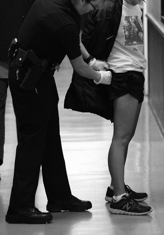 . Officer Cecilia Delgado from the Foothill Stations searches a woman who has been arrested multiple times for prostitution. Sun Valley, CA. 3/6/2014(Photo by John McCoy / Los Angeles Daily News)