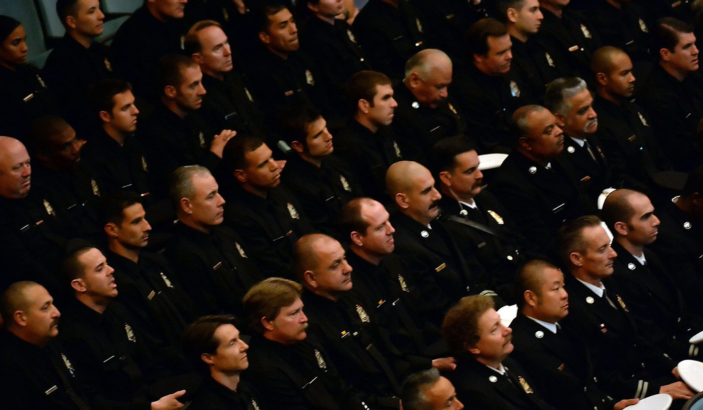 . Members of the Pasadena fire dept. listen to speakers during a celebration of life service for former Pasadena Fire dept. Capt. and California State fire marshall, John Tennant at the Pasadena Civic Auditorium in Pasadena, Calif., on Wednesday, Feb. 5, 2014. (Keith Birmingham Pasadena Star-News)